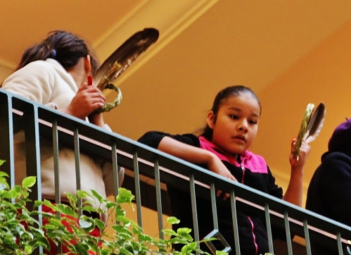 Young Women with Eagle Feather and Sweetgrass
