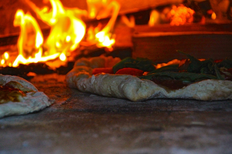 Pizza baking in Earth Oven