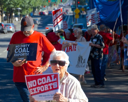 Grandmother in a walker against Coal