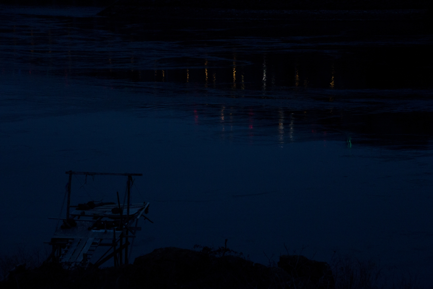 Blue Light Fishing Platform in front of the Military Lights on the NChi'Wana